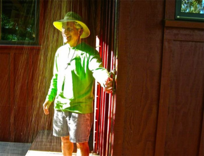 Our host illuminated  -  in a golden shower ...