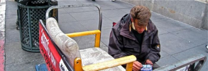 Shoeshine guy checks his lottery ticket ...