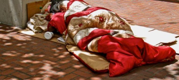 Asleep under a silk flowered duvet ...