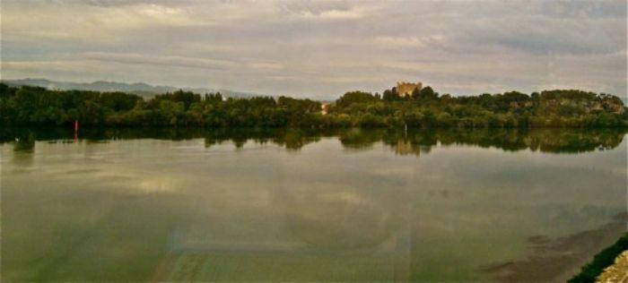Castle above a limpid river ...