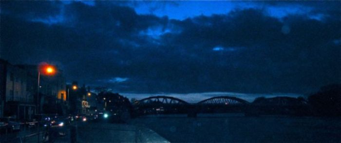 Indigo sky by the river with Barnes Bridge
