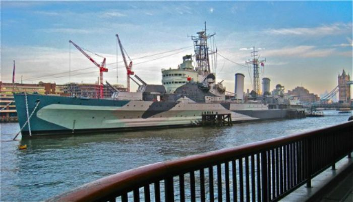 HMS Belfast with Tower Bridge and Canary Wharf in the far distance ...