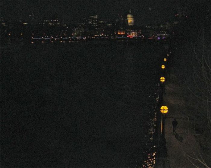 Night claims the Thames with lone silhouette on river path ...