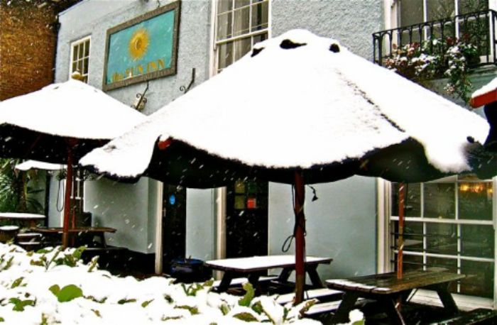 Snow covered sunshades - Sun Inn -  Barnes
