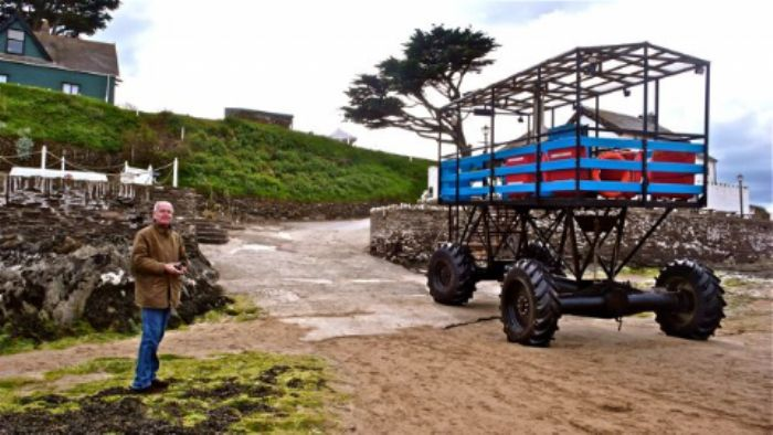 John meets the sea tractor at low tide ...