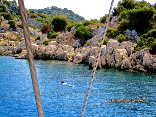 Kekova - a snorkeler views the sunken ruins ...