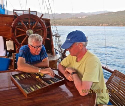 Andrew teaching John how to play backgammon ...