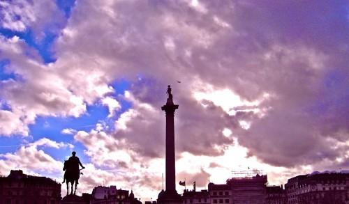 Trafalgar Square - clouds, statues,  aeroplane ...