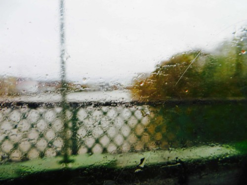 View of Hammersmith Bridge in driving rain from 209 bus ...