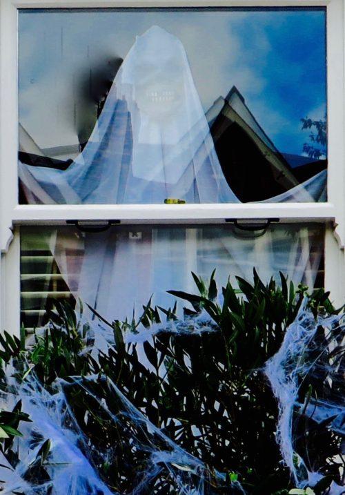 A ghost peers in on Hallowe'en
