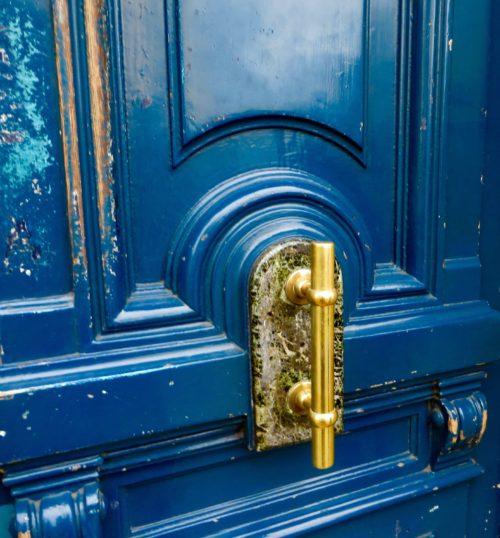 What lies behind the blue door?